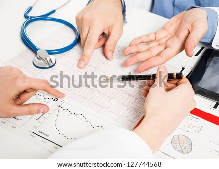 Doctors examining medical tests