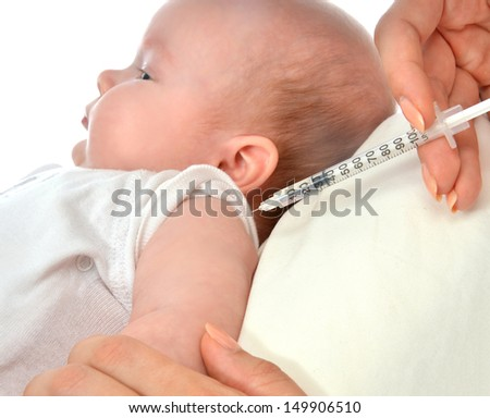 Doctors hand with syringe vaccinating child baby flu injection shot isolated on a white background