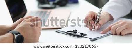Doctors hands writing down patients complaints in medical history closeup. Medical consultation concept Photo stock ©