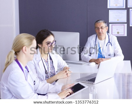 Doctors having a medical discussion in a meeting room #1353776312