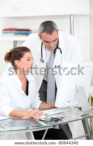 Doctors looking at a computer