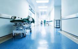 Doctors or nurses walking in hospital hallway, blurred motion.