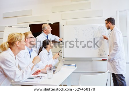 Doctors presenting results in medical seminar