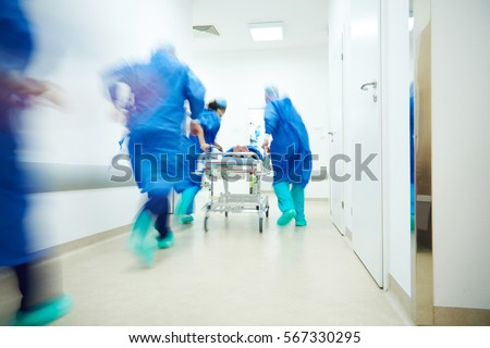 Doctors running for the surgery