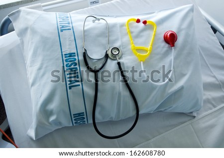 Doctors stethoscope and children stethoscope on hospital pillow in hospital bed.Concept photo