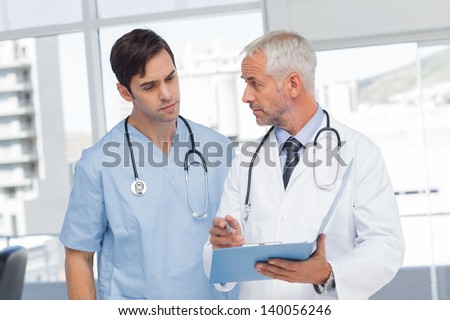 Doctors talking about a file in hospital