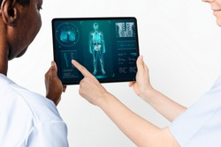 Doctors using tablet to diagnose medical technology