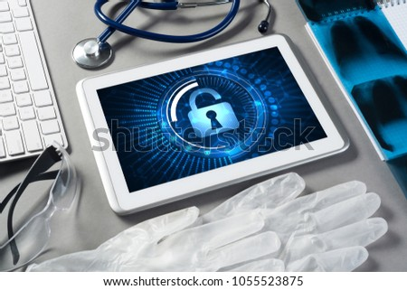 Doctors workplace with white tablet stethoscope and mask #1055523875