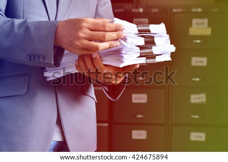 document management,Businessman examining documents #424675894