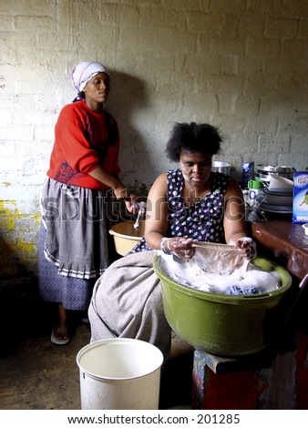 Documentary: Living in a township. Washing by hand