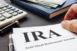 Documents about Individual retirement account IRA on a desk.