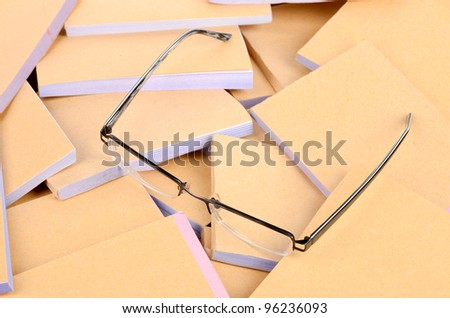 Documents and eye glasses