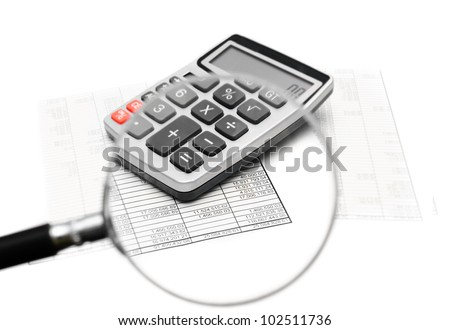 Documents and the calculator through a magnifier.