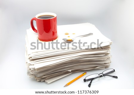 documents, cup of coffee and glasses on white fund