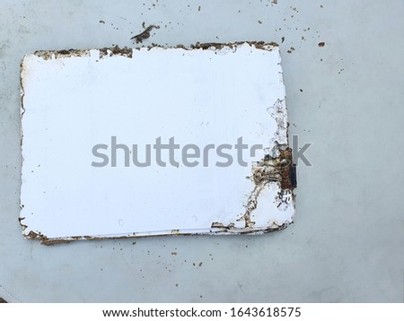 Documents that have been damaged by eating and nesting of termites. Termites are high-class social insects that live in large nests.
