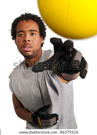 dodge ball player throwing a yellow ball at viewer