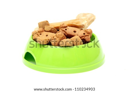 dog dish with food garnished with bone  isolated on white