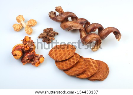 Dog's Dinner/Variety of canine protein treats arrayed on white surface