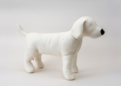 Dog-shaped white mannequin placed on a white background