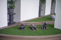 Dog statues on sintetis grass
