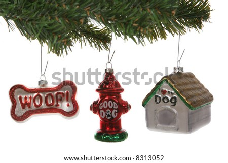 Dog Themed Christmas ornaments on a tree over white