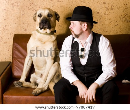Dog with man - stock photo