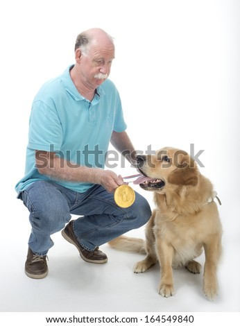 Dog won a golden medal isolated on white