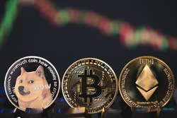 Dogecoin DOGE, Ethereum ETH, Bitcoin BTC group included cryptocurrency and stock chart candlestick down trend lose stock on computer keyboard. Use technology cryptocurrency blockchain. close up coin.
