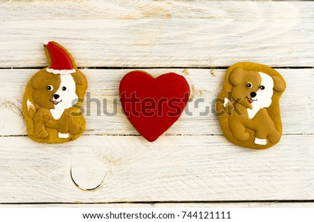 Dogs and heart. Love of dogs. Composition of gingerbread. White background. #744121111