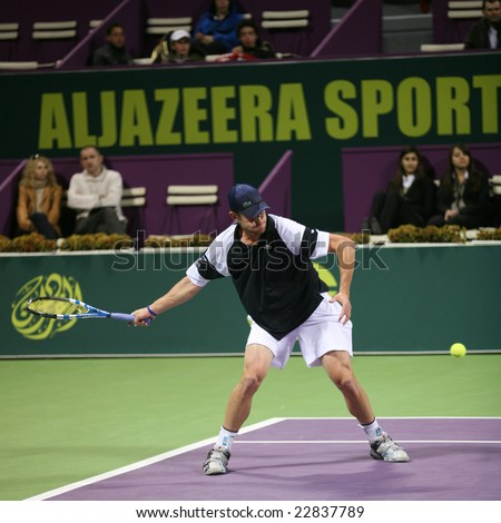 DOHA, Qatar - January 5, 2009: Andy Roddick of the US in action against Ivan Navarro of Spain in the first round of the Doha ExxonMobil Open, 2009