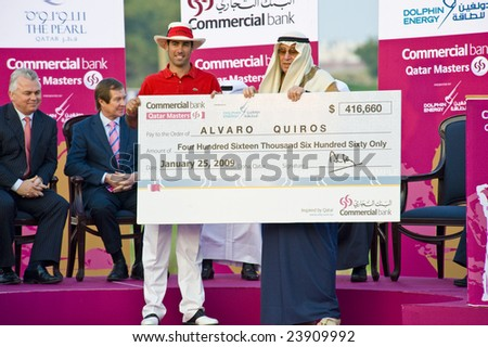 DOHA QATAR - 25 JANUARY 2009: Champion Quiros receives his cheque for over $400k after winning the 2009 Commercial Bank Qatar Masters Tournament on 25 January in Doha, Qatar.