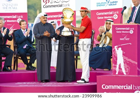 DOHA QATAR - 25 JANUARY 2009: Champion Quiros receives his trohpy after winning the 2009 Commercial Bank Qatar Masters Tournament on 25 January in Doha, Qatar.