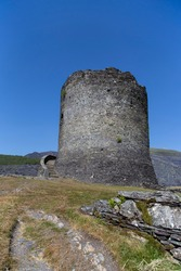 Dolbadarn Castle in Llanberis, Gwynedd,  North Wales.  Medieval castle on a hill with a blue sky