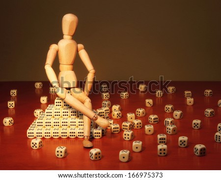 Doll and game dices symbolizing a project manager