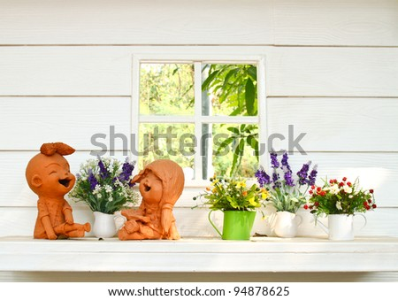 Doll clay and flower in ornamental garden