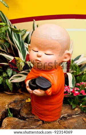 Doll clay baby monk used in ornamental gardens in Thailand