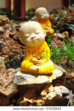 Doll clay monk used in ornamental garden in Thailand