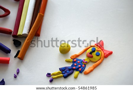 Doll from colorful clay dough  (plasticine) made by child