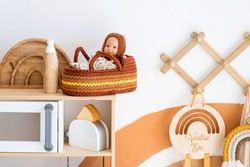 doll in a knitted cradle. scandinavian children's room