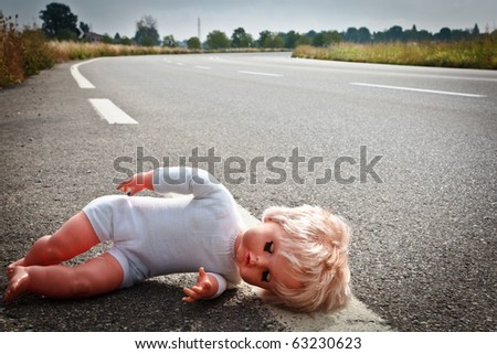 doll leave on highway lane