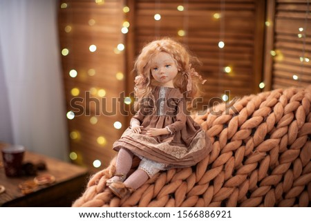 doll, made by hand from textiles, in retro style. a designer doll with a human face. creating dolls for the new year holiday. exclusive gift for the new year. Christmas gift