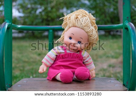 Doll on the swing #1153893280