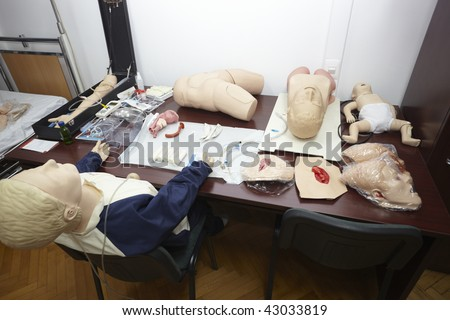 doll patient lying in hospital bed
