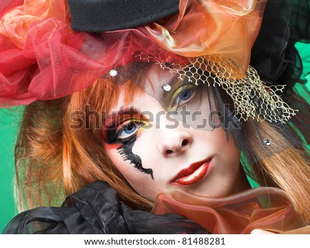 Doll. Young pretty lady with creative make-up and in exotic hat. #81488281
