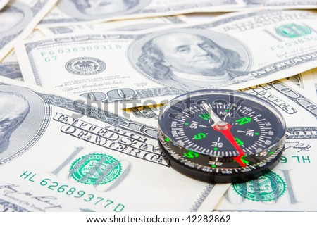 Dollar and compass. Business background