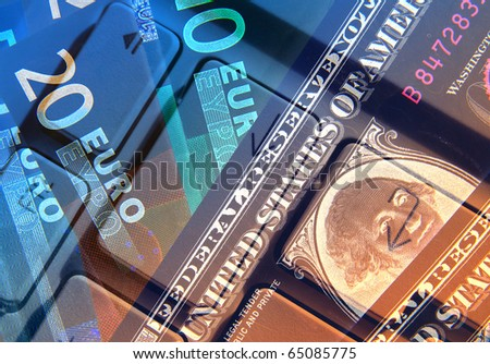 Dollar and Euro banknotes overlaid with keyboard abstract