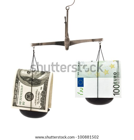 dollar and euro on scales isolated on white background