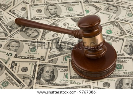 Dollar and gavel. Symbol for court costs and auctions.