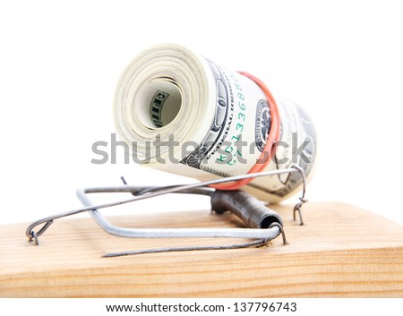 dollar banknotes roll in a mousetrap as concept of money security or bait