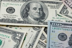 Dollar banknotes spread out. One dollar to one hundred dollar banknotes, rare two dollar in between cash pile. Background with USD banknotes. Cash 100 and fifty USD bills
